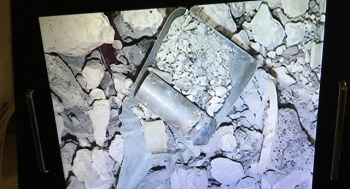 A view of radioactively contaminated concrete debris found inside one of 27 containers being processed at the former spent nuclear fuel hot cells at the Idaho Nuclear Technology and Engineering Center.