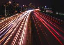 Photo of highway full of car lights.