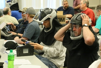 Bonneville Power Administration employees participate in hands-on training with helmets that contain powered air-purifying respirators in a course led by worker-trainers at the HAMMER Federal Training Center.