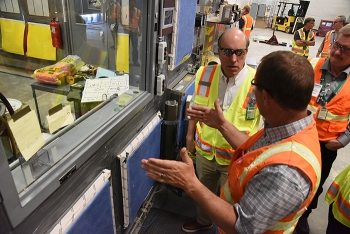 Fluor-Idaho Accelerated Retrieval Project Operations Manager Jason Chapple, left, briefs DOE Under Secretary for Science Paul Dabbar at the ARP VII, where crews size-reduce and decontaminate large items from the Advanced Mixed Waste Treatment Project.