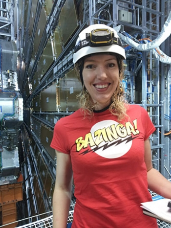 Brookhaven Lab physicist Claire Lee stands in front of the muon spectrometer of the ATLAS detector.