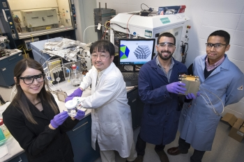 In Brookhaven Lab's Chemistry Division, Melissa Vega Cartagena and Luis Betancourt De León (left and third from left, respectively) were two of five students from the University of Puerto Rico who were able to continue their research at Brookhaven.