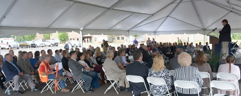 Portsmouth/Paducah Project Office Manager Robert Edwards addresses the audience at EM's Portsmouth Site ceremony commemorating the first land transfer to the southern Ohio community.
