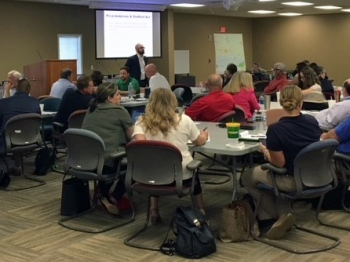 Participants in the Ingestion Pathway Exercise discuss techniques and approaches for a coordinated emergency response during refresher course in Alabama.