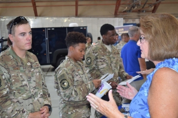 Tracy Loughead, acting manager of the OST Office of Training and Resources, talks to a Kirtland Air Force Base security force member about opportunities for federal agent employment when he leaves the military.
