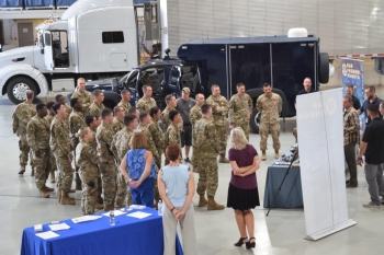 Kirtland Air Force Base security officers attended an open house at the OST aviation hangar to get briefings on its mission and get a close-up look at specialized vehicles and aircraft used to transport materials and personnel.