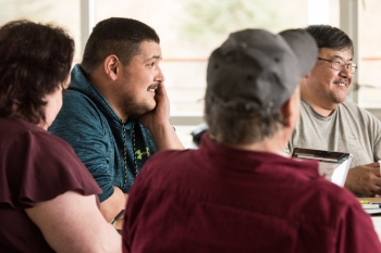 A group of people attend a workshop in Alaska.
