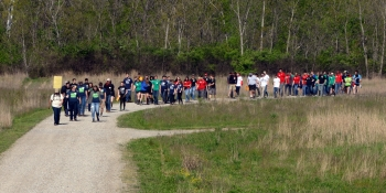 Envirothon students hike from one testing station to another.