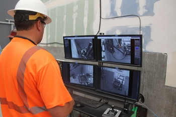Skilled operators in the 324 Building mockup now train on a remote excavator, using newly installed cameras and lighting.