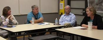 Left to right, EM Assistant Secretary Anne White talks with Bill Wilborn, Jhon Carilli, and Christine Baker of the EM Nevada Program during an all-hands meeting.