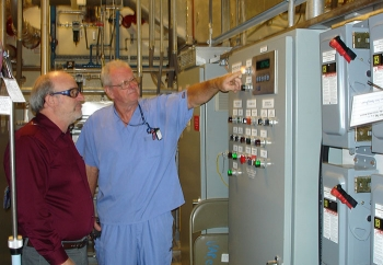 Mid-America Conversion Services Operator Bobby Ferren, right, is pictured with EM Depleted Uranium Hexafluoride Deputy Federal Project Director James Johnson at the Paducah cylinder transfer system startup.