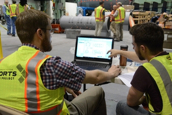 Carnegie Mellon University's Ralph Boirum, left, and EM Fellow Michael DiBono evaluate data.