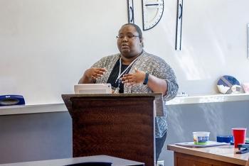 The Oak Ridge Office of Environmental Management's Vanna Gaffney speaks about radiation protection at Oak Ridge City Schools' Back to School Professional Development Day.
