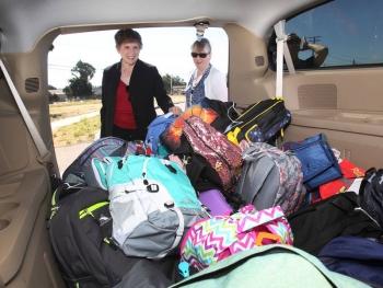 Dori Ellis loads van with backpacks