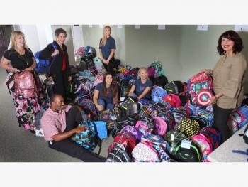 Volunteers organize backpacks