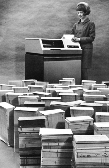 A Kansas City National Security Campus employee with disk drive and punch cards
