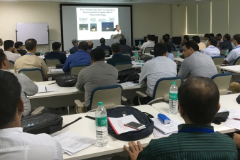 Dr. Fred Harper explaining the science of radioactive material dispersal to an audience of Indian first responders