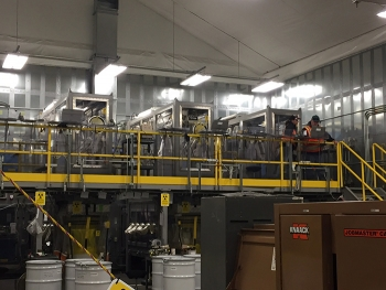 Waste from the Accelerated Retrieval Project VIII is processed in these drum packaging stations.
