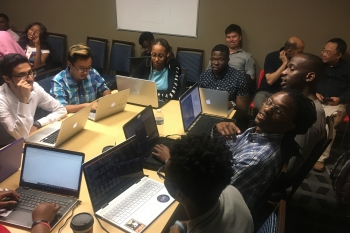 Students from Prairie View A&M University and Tennessee State University discuss the group project.