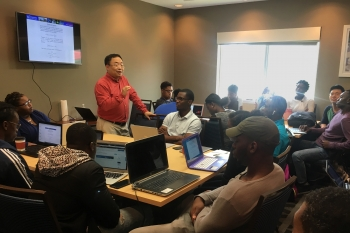 Dr. Lizhi Ouyang, a physics professor from Tennessee State University gives a lecture to the computational workshop participants.