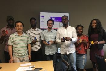 Final presentation winners, from left: Alvin Ibeabuchi, Huajun Fan, Adedapo Adetayo, Ali Rafique, Iyanuloluwa Olalumade, Joelle Tshikuta, and Prevailer Mba.