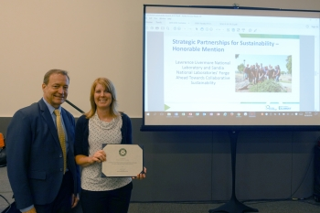 """Kevin Carroll, DOE Sustainability Performance Office presented Heather Ottaway of LLNL with the Strategic Partnerships for Sustainability Award on behalf of LLNL and Sandia's joint """"Forge Ahead Towards Collaborative Sustainability"""" project"""