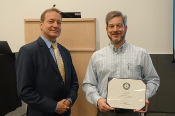 """Wayne Evelo, NNSA Office of Environment and Sustainability accepted the Sustainability Champion Honorable Mention Award for """"Bicycle Commuter Group Makes Strides"""""""