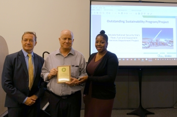"""Kevin Carroll, DOE Sustainability Performance Office (left), presented Doug Trone and Patrice Claxton of Nevada National Security Site with the Outstanding Sustainability Program/ Project Award for """"Fleet, Fuel and Equipment Services Department""""."""