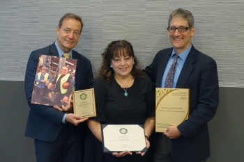 Rose Montalvo (center) accepted Patricia Gallagher's Sustainability Champion Award on her behalf along with Los Alamos National Laboratory's Innovative Approach to Sustainability Honorable Mention Award and its Green Buy Award from DOE Office of Health, S