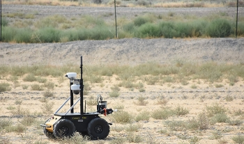 A rover crosses the terrain near Hanford's SX Tank Farm during a recent field demonstration.