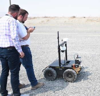 Washington River Protection Solutions staffers prepare the rover for its next demonstration.