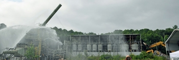 Crews take down a 100-foot stack at the Toxic Substances Control Act Incinerator.