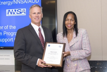 Col. Mark Arnholt, Director of Operations with NNSA's Office of Secure Transportation, accepts his award from Carolyn Austin-Diggs of the General Services Administration.