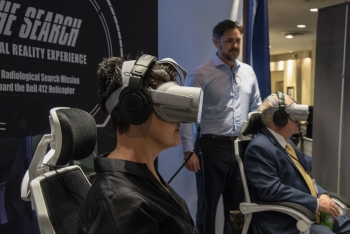 Attendees experience virtual reality simulation at the RAP 60 event.