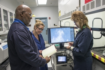 Rodney Gantt, laboratory specialist, Linda Youmans, director of the Industrial Hygiene Laboratory, and Becky Chavous, laboratory specialist, test the new radiological asbestos monitoring equipment to ensure it meets laboratory accreditation requirements.