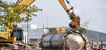 Made of stainless steel, the 74-foot silo will be shipped for recycling.