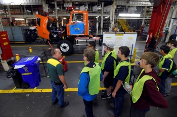 a photo of people standing in a manufacturing facility