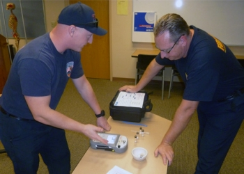Nevada National Security Site fire and rescue personnel with handheld chemical analyzers that use infrared technology.