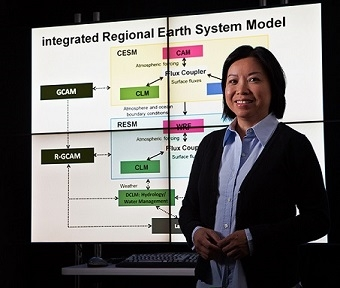Researcher standing in front of a Powerpoint slide.