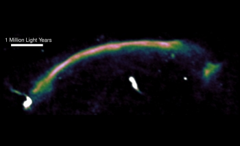 A radio image highlights a shock wave — seen here as the bright arc — in a merging cluster of galaxies.