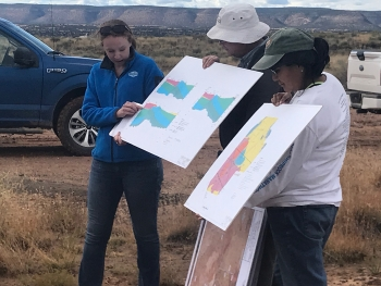 Alison Kuhlman and Dick Johnson (LM Support contractors) and Bernadette Tsosie (LM) explain the hydrogeology of the Bluewater, New Mexico, Disposal Site.