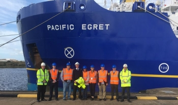 EM Assistant Secretary Anne White, center, and other members of the DOE delegation toured the Pacific Egret.
