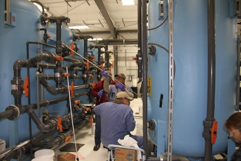Workers upgrade tanks used to treat groundwater at the Hanford Site