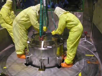 A crew readies a transport cask for the shipment of Training, Research, Isotopes, General Atomics fuel.