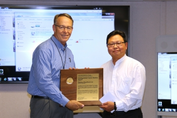 Stephen Loo is presented with the NNSA Administrator's Distinguished Career Service Award by Michael Flynn, Livermore Field Office acting deputy field manager.