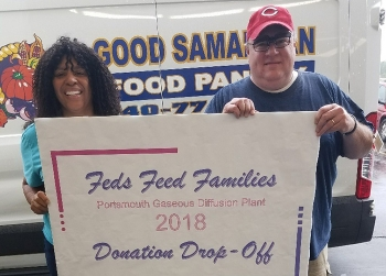 Dewintus Powell, left, of the Portsmouth/Paducah Project Office, with Rob Downard of the Ross County Ohio Good Samaritan Network Food Pantry at a donation drop-off.