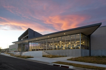 Exterior photo of the National Renewable Energy Laboratory Cafe at sunset.