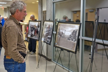 Attendee reads the interpretive information on one of the display's historic photos.