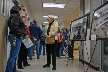 Attendees discuss the historic photo display.