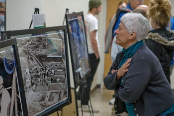 Attendee looks at a photo of the Climax Uranium Company Mill.